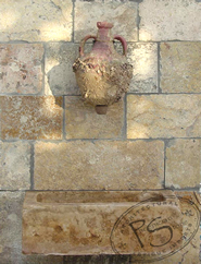 Biblical Stone behind a Roman Amphora Wall Fountain